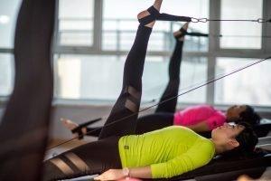 Women doing leg exercises in Pilates studio